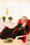 Pensioner lady on the phone Stock Photo