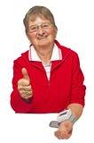 Pensioner is measuring her blood pressure Stock Image