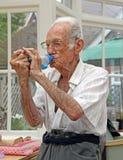 Pensioner on medication pump Royalty Free Stock Image