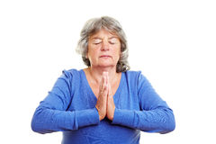 Pensioner meditating Royalty Free Stock Image