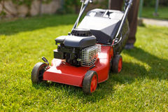 Pensioner mowing lawn with machine Royalty Free Stock Photo