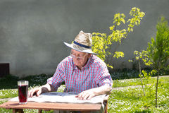 Pensioner with newspaper Royalty Free Stock Photo