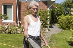 Pensioner pouring his garden Royalty Free Stock Photography