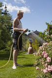 Pensioner pours his garden Royalty Free Stock Image