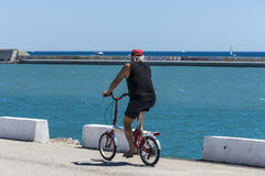 Pensioner ridden a bicycle Royalty Free Stock Images
