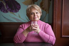 Pensioner Russian woman in cafe Stock Photography