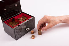 Pensioner stacks coins Stock Photos