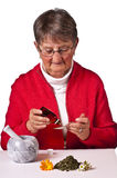 Pensioner taking herbal drops Royalty Free Stock Photography