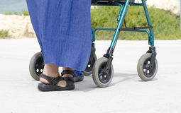 Pensioner with walking aid Stock Photo