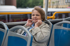 Pensioner woman in touristic bus Royalty Free Stock Images