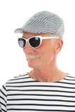 Pensionerad man för stående Arkivbild