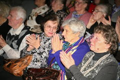 Pensioners - the audience of the charity concert Royalty Free Stock Photo