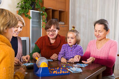 Pensioners with child playing board Stock Photo