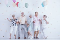 Pensioners dancing at party. Group of pensioners dancing at a new year`s celebration party Royalty Free Stock Image