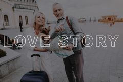 Pensioners with Dog. Old Couple with Travel Bag. stock photos