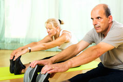 Pensioners doing exercises indoor Royalty Free Stock Photos