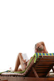 Pensioners Enjoying Holiday. An eldery reading a book while laying back enjoying his vacation Stock Images