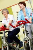 Pensioners in gym Royalty Free Stock Photos