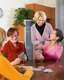 Pensioners having fun with cards Royalty Free Stock Images