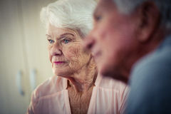 Pensioners interacting. In retirement house Royalty Free Stock Image