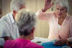 Pensioners interacting. In retirement house Stock Photos