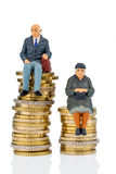 Pensioners and pensioner on money stack. Pensioners and pensioner sitting on money stack, symbol photo for retirement and inequality Stock Image