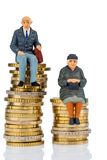Pensioners and pensioner on money stack. Pensioners and pensioner sitting on money stack, symbol photo for retirement and inequality Stock Photo