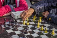 Pensioners play chess in a park Stock Photo
