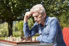 Pensioners playing chess Stock Photo