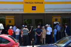 Pensioners queue at greek bank Stock Photo