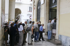 Pensioners queue outside a National Bank branch as banks only op Royalty Free Stock Photo