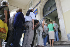 Pensioners queue outside a National Bank branch as banks only op Royalty Free Stock Photos