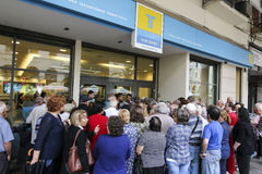 Pensioners queue outside a National Bank branch as banks only op Royalty Free Stock Images