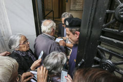 Pensioners queue outside a National Bank branch as banks only op Royalty Free Stock Photography