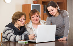 Pensioners and relative with laptop Stock Image