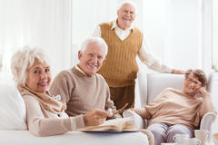 Pensioners of retirement home. Happy pensioners of retirement home relaxing together Royalty Free Stock Photography