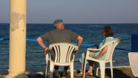 Pensioners by sea. Elderly couple by sea in Sousse, Tunisia stock footage