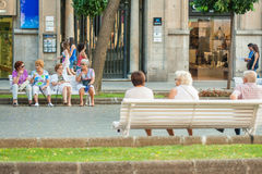 Pensioners sit on benches. Communication of the elderly. Tourists and citizens on the celebration of Santa Tecla of Tarragona on September 17, 2011. Photo Stock Photography