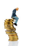 Pensioners sitting on a pile of money Royalty Free Stock Images