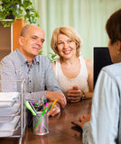 Pensioners talking with manager Royalty Free Stock Photo