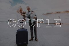 Pensioners with Travel Bag.Couple Travel with Dog. stock photos