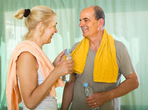 Pensioners with water after fitness Stock Photo