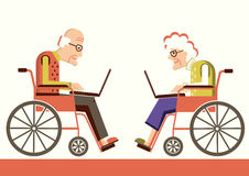 Pensioners in a wheelchairs with laptops Royalty Free Stock Photo
