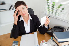 Pensive accountant checking receipts Royalty Free Stock Photography