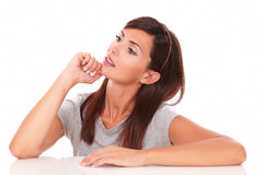 Pensive adult female wondering and looking up stock photos