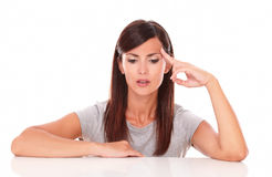 Pensive adult lady wondering while looking down Royalty Free Stock Photo