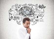 Pensive African American businessman, brain, plan Stock Photo
