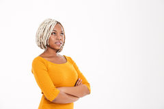 Pensive african american woman with arms crossed and looking up Stock Image