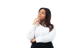 Pensive african businesswoman looking up Royalty Free Stock Image