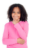 Pensive african little girl sitting on the floor Royalty Free Stock Photography